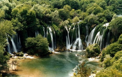 While the sun shines over the waterfalls is always a rainbow. At night in moon light the stream of water looks like silver. The Kravica waterfalls literally spells tourists