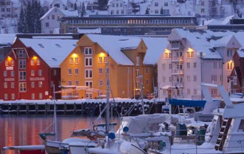 Tromso is situated on the island and is surrounded by fjords, mountains, islands. Local residents are proud of the most northern university and botanical garden, breweries