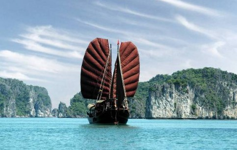Hạ Long Bay is a UNESCO World Heritage Site. Thousands of tiny islands, rising out of transparent emerald water; fine beaches and fabulous grottos, created by waves and wind