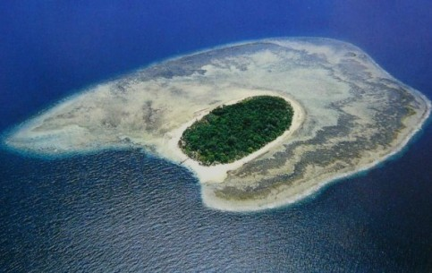 Sipadan - tiny islet only 500 metres in diameter, National Park of Malaysia. Ideal diving location: coral reefs, submarine cave.