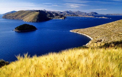 Titicaca - famous mountain lake in Andes; unique floating islands; ancient traditions of Uros Indians; reed canoes and huts.